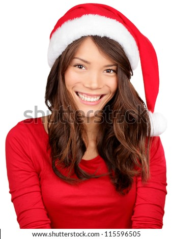 Christmas girl wearing santa hat. Portrait of Asian woman smiling happy on white background.