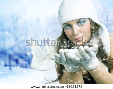 Christmas Girl.Winter Girl Blowing Snow
