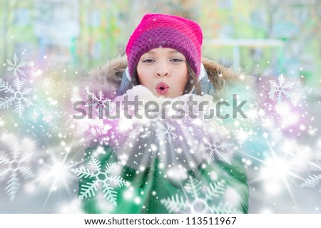 Christmas Girl.Winter woman Blowing Snow. Front View