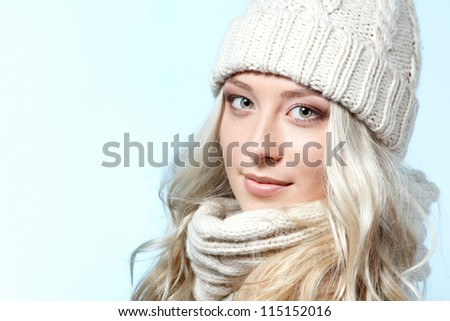 christmas girl, young beautiful smiling girl over blue background