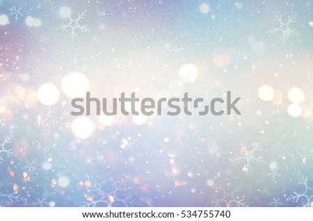Christmas glow winter background. Blue holiday glowing backdrop. Defocused snow Background With Blinking Stars and snowflakes. Blurred Bokeh. #534755740