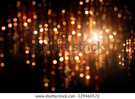 Christmas gold background. Golden holiday glowing backdrop. Defocused Background With Blinking Stars. Blurred Bokeh curtain