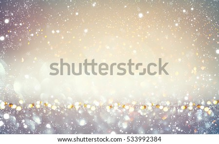Christmas gold background. Golden holiday glowing backdrop. Defocused Background With Blinking Stars. Blurred Bokeh. #533992384