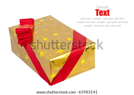 Christmas gold gift box tied with red ribbon bow on white background