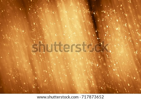 christmas golden abstract sparkles or glitter light festive gold backgrounddefocused circles bokeh or