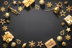 Christmas golden decoration with gift boxes on dark background. Template for greeting card