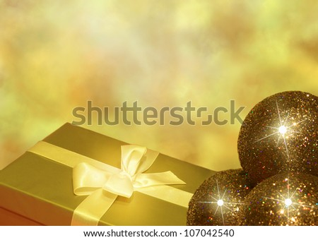 Christmas golden gift and baubles background