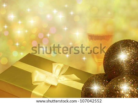Christmas golden gift and champagne with bauble abstract design