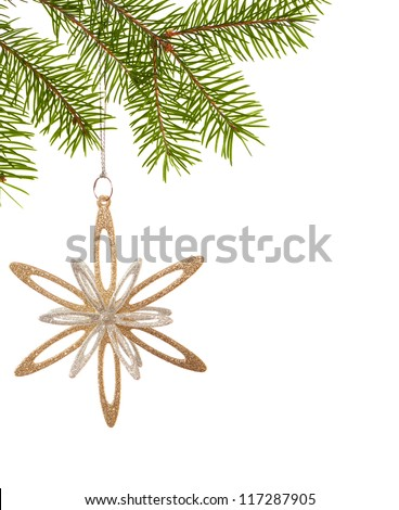 Christmas golden snowflake hanging on a spruce on white background