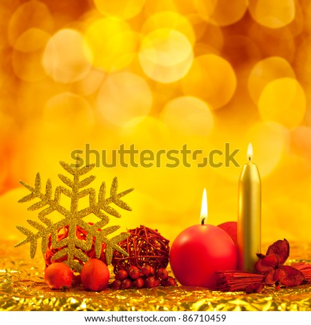 christmas golden snowflake with red candles on bokeh lights background