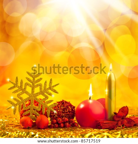 christmas golden snowflake with red candles on bokeh lights background [Photo Illustration] - stock photo