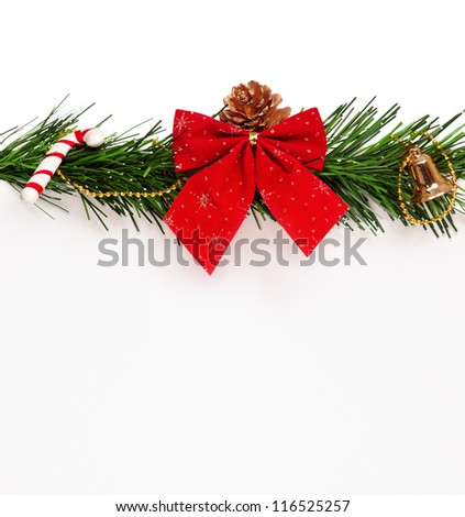 Christmas green artificial branch and red bow with empty board on white background