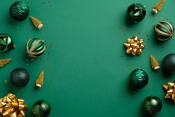 Christmas green background with baubles and golden decorations. Xmas frame with copy space. Greeting card mockup, banner template.
