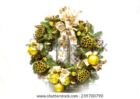 Christmas green wreath from firs brunches with decoration - dry oranges, poinsettia flowers and cones. On wooden background with copy space.