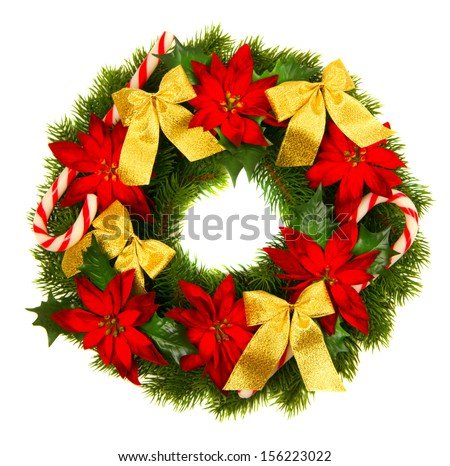 Christmas green wreath from firs brunches with decoration - golden bows, poinsettia flowers and lollipop. Isolated on white background.