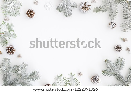 Christmas greeting card. Christmas frame border with copy space. Noel festive background. New year symbol. Fir branches snow and pine cones. Minimal flat lat xmas design #1222991926