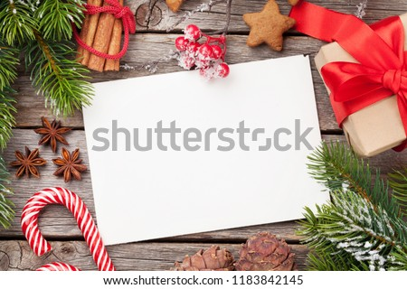 Christmas greeting card, decor and snow fir tree. Top view with space for your xmas wishes #1183842145