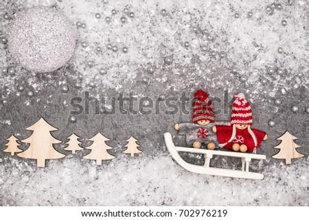 Christmas greeting card. Noel festive background. New year symbol. Children playing theme. #702976219