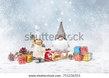Christmas greeting card. Noel gnomes, small gifts, snow texture. Christmas symbol. #751236355