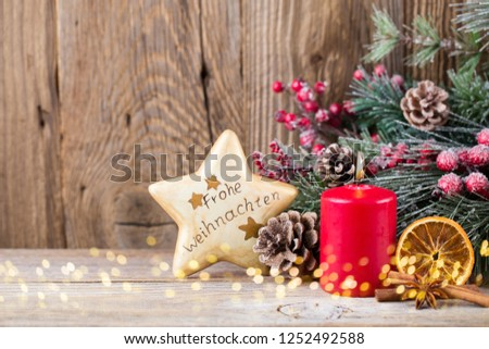 Christmas greeting card. Translation: Merry Christmas in German.  Festive decoration on wooden background. New Year concept. Copy space.  Flat lay. Top view. #1252492588