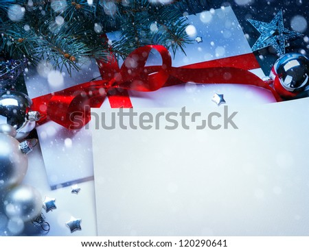 Christmas greeting card with a branch of tree and Christmas decorations