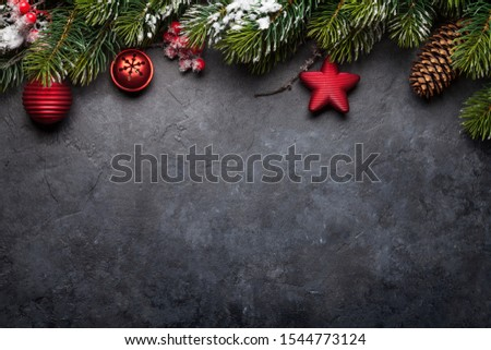 Christmas greeting card with decorated fir tree and copy space for your xmas greetings. Top view flat lay #1544773124