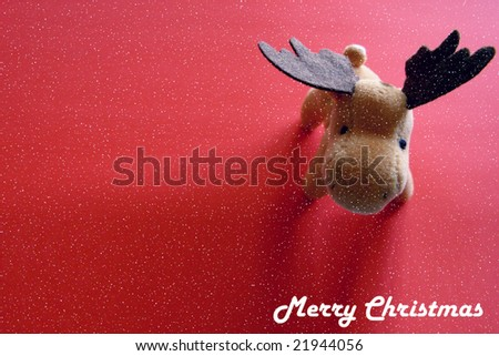 Christmas greeting card with deer over red background