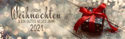 Christmas greeting card with text in German -  Frohe Weihnachten means Merry Christmas and Happy New Year 2021 - Gift box with red bow