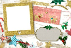 Christmas greeting with photo frame in times of coronavirus.Covid-19  face mask customize with two gold  reindeers,needle, thimble, ornaments, empty photo frame on an old wooden table. Copy spac