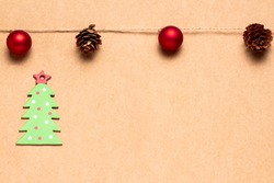 Christmas greetings card with a garland of balls and pineapples and green cardboard tree. Space for copying. Advertising banner