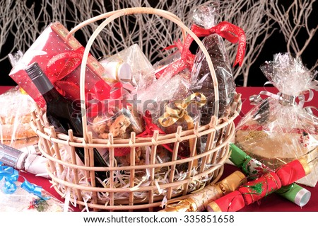 Stock Photo Christmas hamper basket with a chocolate Santa, cookies and a bottle of wine