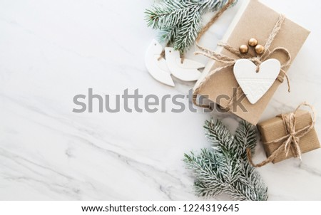 Christmas handmade gift boxes on white marble background top view. Merry Christmas greeting card, frame. Winter xmas holiday theme. Happy New Year. Noel. Flat lay #1224319645