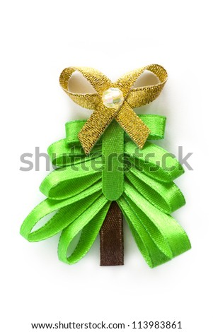 Christmas handmade ribbon fir tree with gold bow. Isolated white background.