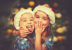 Christmas Happy funny children twins sisters hugging