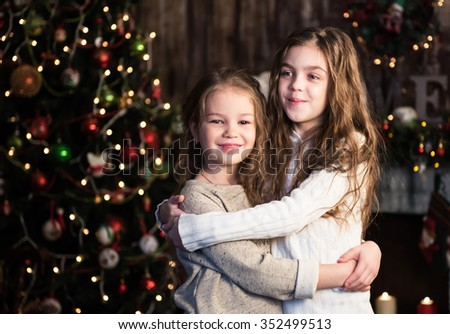 christmas happy funny children - two girls hugging