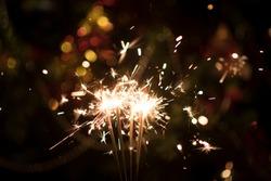 Christmas holding bengal burning sparkler light