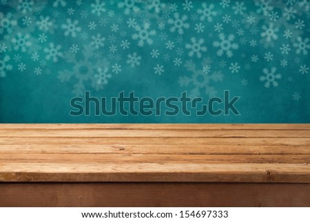 Christmas holiday background with empty wooden table. Ready for product montage display