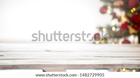 Christmas holiday background with empty wooden table top over festive bokeh light decorate. For create montage product display