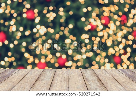 Christmas holiday background with empty wooden table top over festive bokeh light decorate on Christmas tree. For create montage product display