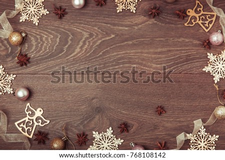 Christmas holiday composition. Festive creative gold pattern, spruce branches, xmas tree, xmas golden decor holiday ball with ribbon on wooden brown background. Flat lay, top view #768108142
