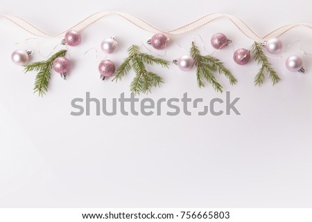 Christmas holiday composition. Festive creative gold pattern, spruce branches, xmas tree, xmas pink decor holiday ball with ribbon on white background. Flat lay, top view #756665803