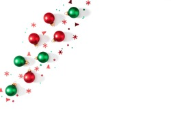 Christmas holiday composition. Frame made of red and green balls  on white background. Christmas, New Year, winter concept. Flat lay, top view, copy space