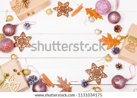 Christmas holiday composition, ornament. Festive creative gold pattern, spruce branches, xmas tree, xmas golden decor holiday ball with gift and ribbon on wooden white background. Flat lay, top view #1131034175