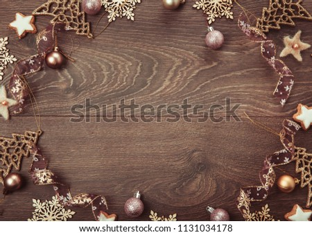 Christmas holiday composition, ornament. Festive creative gold pattern, spruce branches, xmas tree, xmas golden decor holiday ball with gift and ribbon on wooden brown background. Flat lay, top view #1131034178