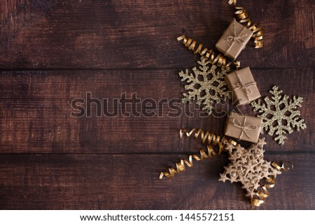 Christmas holiday composition, ornament. Festive creative gold pattern, spruce branches, xmas tree, xmas golden decor holiday ball with gift and ribbon on wooden brown background. Flat lay, top view. #1445572151