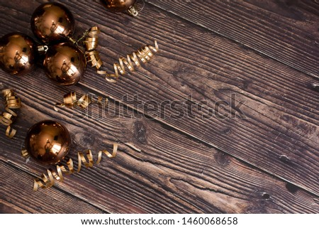 Christmas holiday composition, ornament. Festive creative gold pattern, spruce branches, xmas tree, xmas golden decor holiday ball with gift and ribbon on wooden brown background. Flat lay, top view. #1460068658