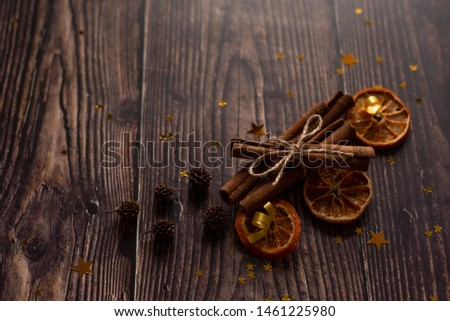 Christmas holiday composition, ornament. Festive creative gold pattern, spruce branches, xmas tree, xmas golden decor holiday ball with gift and ribbon on wooden brown background. Flat lay, top view. #1461225980