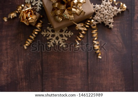 Christmas holiday composition, ornament. Festive creative gold pattern, spruce branches, xmas tree, xmas golden decor holiday ball with gift and ribbon on wooden brown background. Flat lay, top view. #1461225989