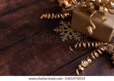 Christmas holiday composition, ornament. Festive creative gold pattern, spruce branches, xmas tree, xmas golden decor holiday ball with gift and ribbon on wooden brown background. Flat lay, top view. #1465470014