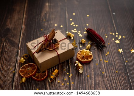 Christmas holiday composition, ornament. Festive creative gold pattern, spruce branches, xmas tree, xmas golden decor holiday ball with gift and ribbon on wooden brown background. Flat lay, top view. #1494688658